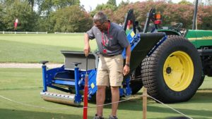 Turf tractor student on golf green